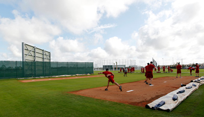 Red Sox pitchers warm up in the bullpen area at jetBlue Park.