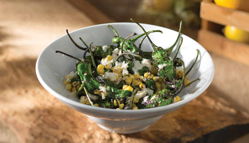 Blistered Shishito Peppers recipe with roasted corn, feta and goat cheese - Seasons 52 - light and flavorful springtime dishes