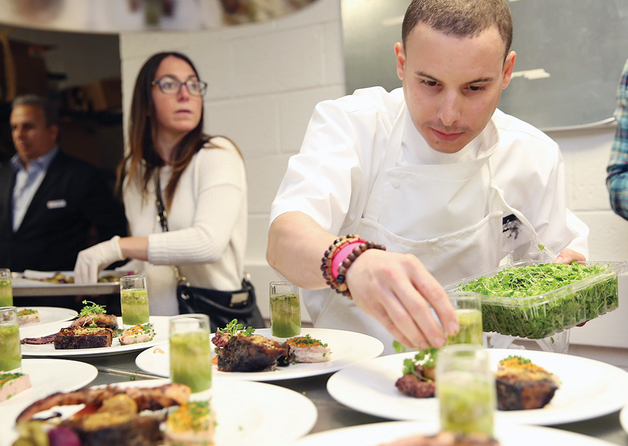 Chef Christian Cuevas plates during Swine to Vine, a Bank of America pairing seminar.
