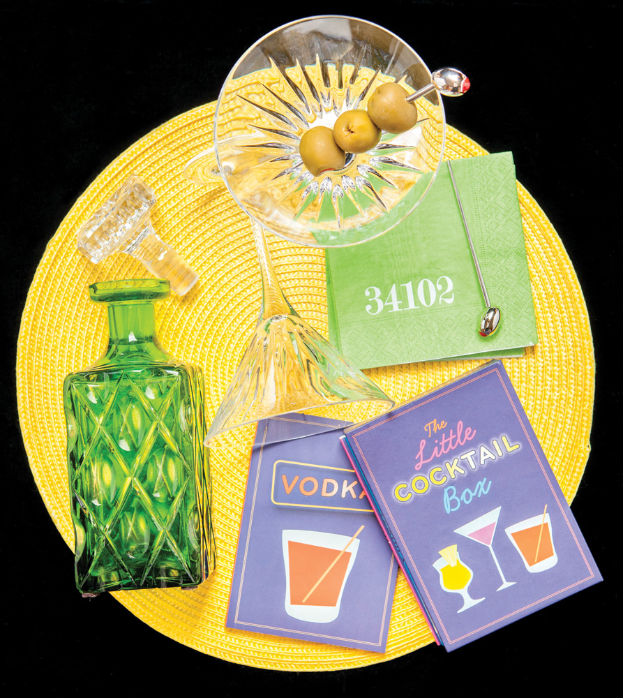 Classic Naples - Green glass decanter, Summerfields, Naples; The Little Cocktail set of books, martini glasses with olive picks, 34102 napkins, Br Uno, Naples; yellow placemat, Horse of a Different Color, Naples