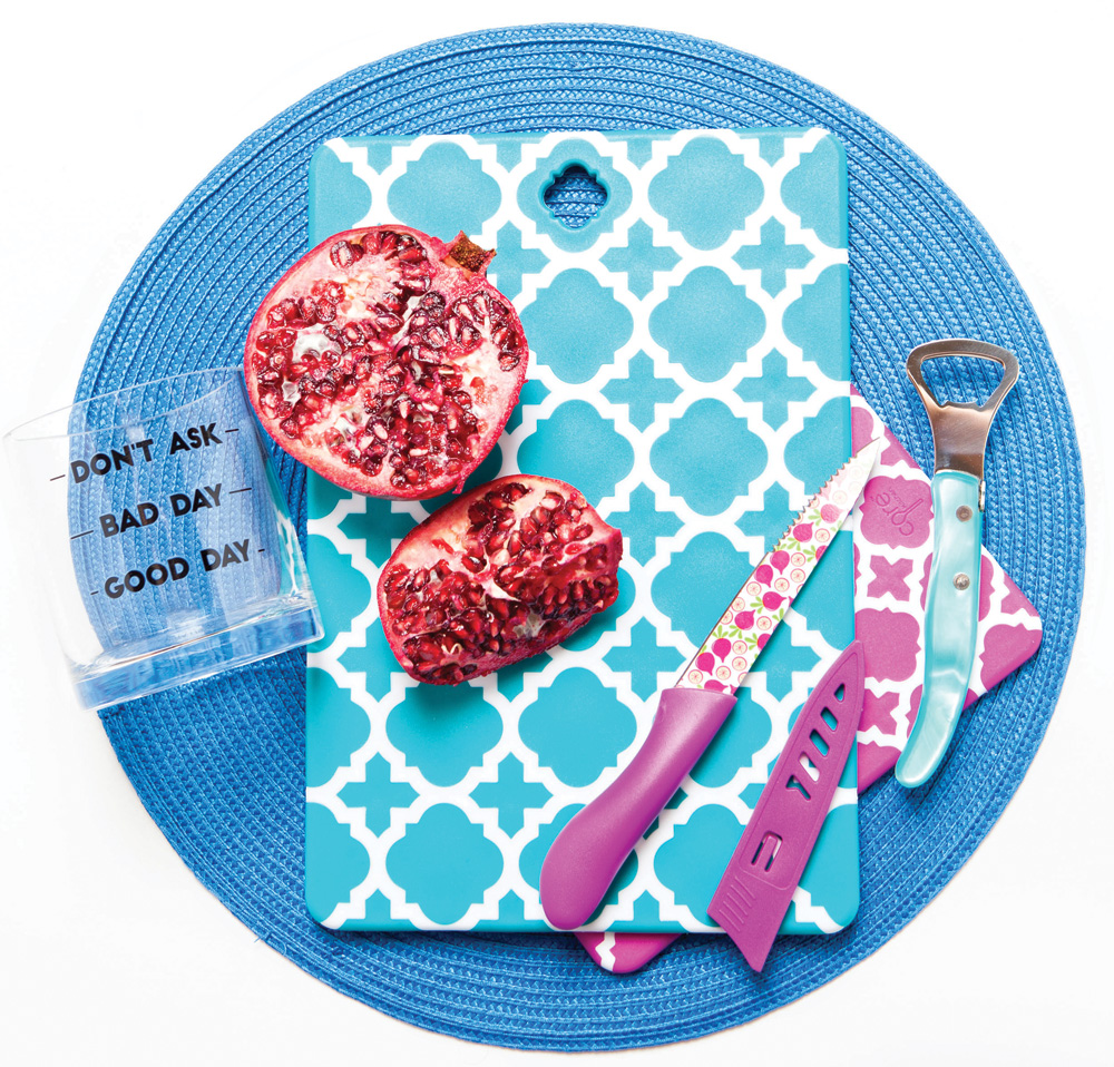 GARNISH IN STYLE Patterned cutting boards, knife, bottle opener, Summerfields, Naples; cocktail glass, Tickled Pink, Naples; blue placemat, Horse of a Different Color, Naples