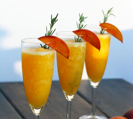 Sparkling Rosemary-Peach Bellini cocktail recipe - Sparkling New Year's Cocktail Recipes
