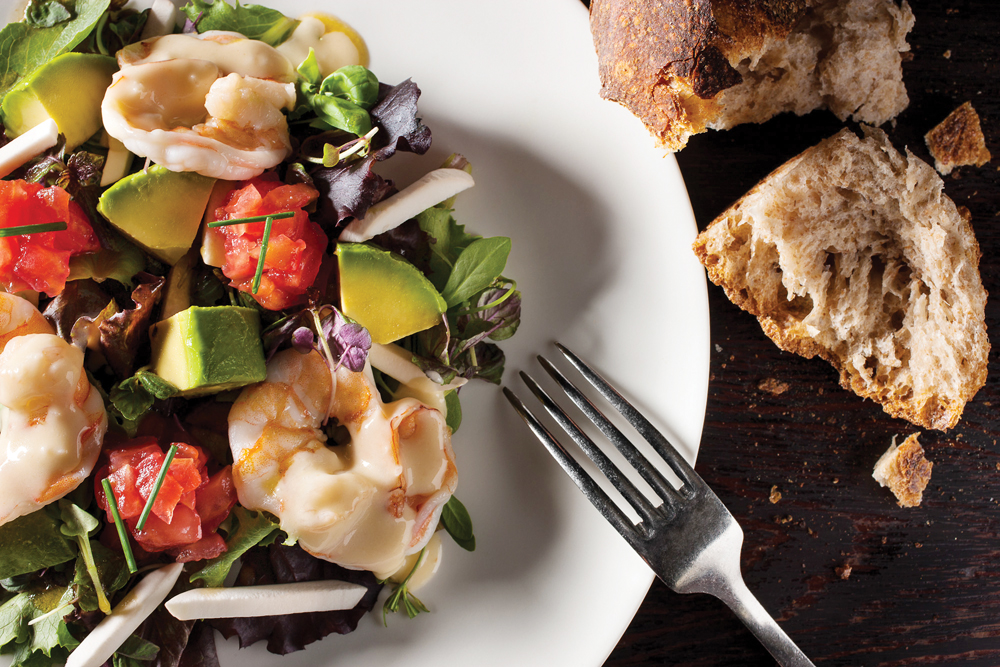 Dune serves seafood delicacies like steamed shrimp salad.
