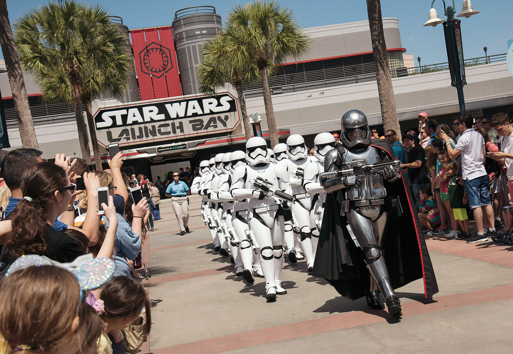 At various times each day, the menacing Captain Phasma leads a squad of First Order stormtroopers as they march in formation from Star Wars Launch Bay to the Center Stage area at Disney's Hollywood Studios in an intimidating demonstration of the First Order's indomitable strength. (Preston Mack, photographer)