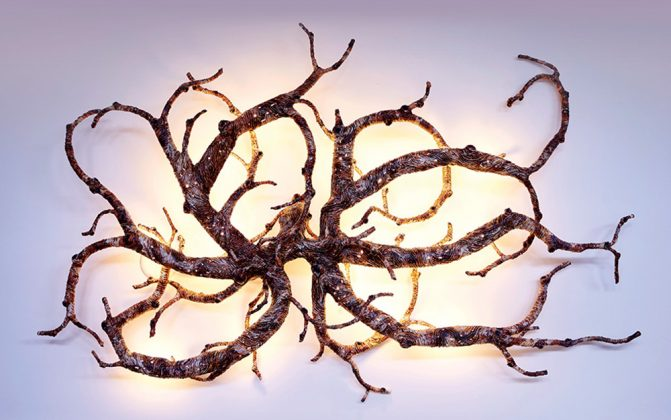 Wall sconce made of steel sculptured branches.