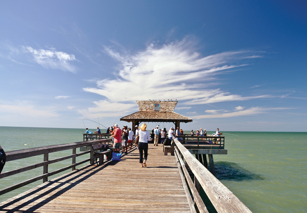 Naples Pier is a popular spot for fishing, people watching, dolphin and bird watching and sunsets.