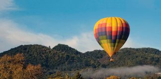 Hot air Balloon over Napa Valley and early morning fog near Yountville California