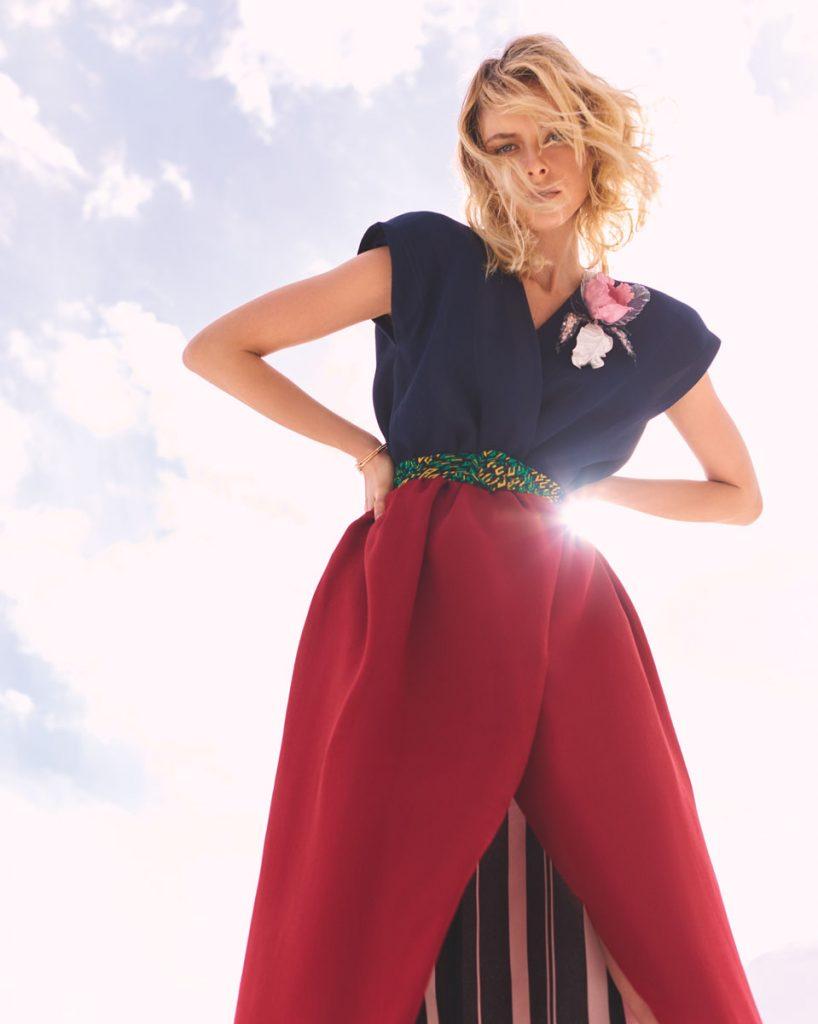 Louis Vuitton dress, belt, flower pin; Tiffany & Co. bracelets.