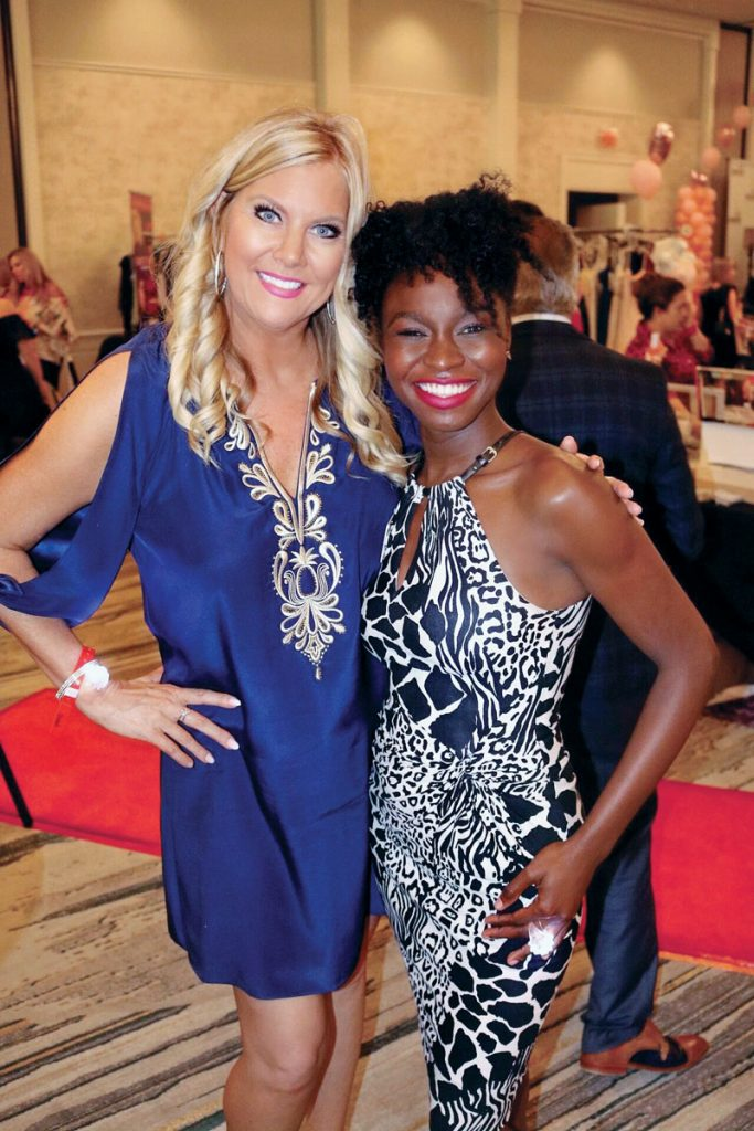 Tracy Wenkman, in Lilly Pulitzer, and Wotts Mercy, in White House Black Market, at PACE Center for Girls Collier's Love That Dress