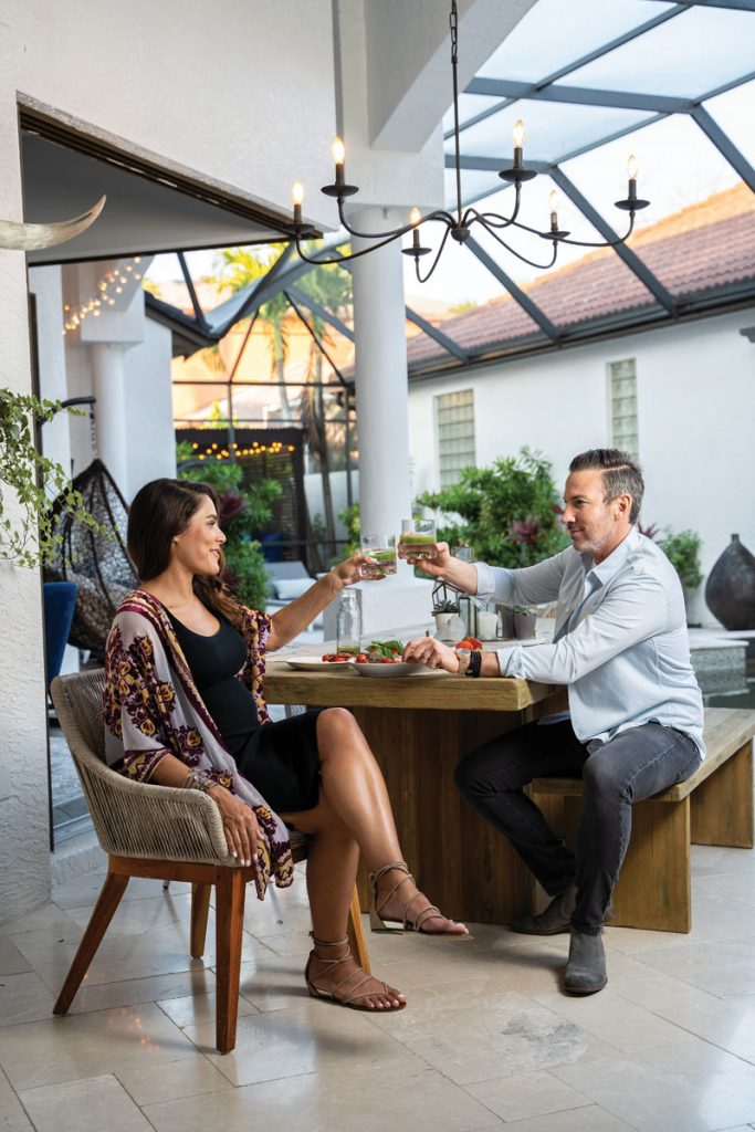 Incorporating healthy rituals and hobbies is important to Shannon and Ben, so they cheers with a green juice at their outdoor dining table, Photo by Vanessa Rogers