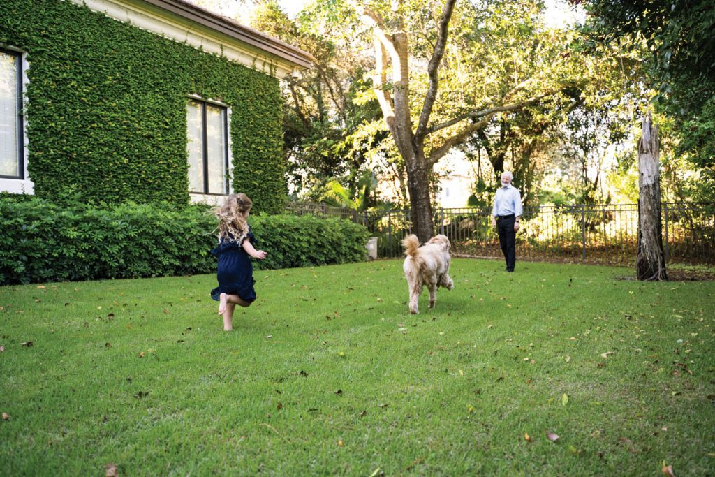 Randy Kurtz has a large, fenced-in backyard for playing with his dog, Bentley, after work and running around with his three grandchildren, including Isla Gordon