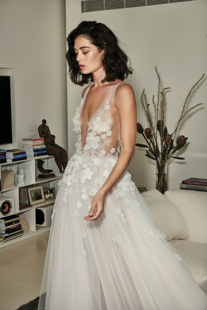 Ari silk tulle gown with cascading 3D flowers ($9,790), Mira Zwillinger, Boca Raton Bridal