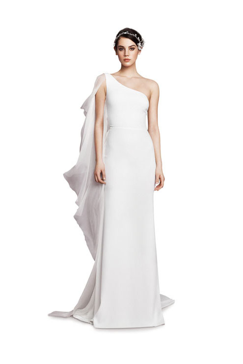 Asymmetric crêpe gown with silk chiffon shoulder overlay in off-white ($3,625), Daalarna Couture, Amable Bridal, Miami