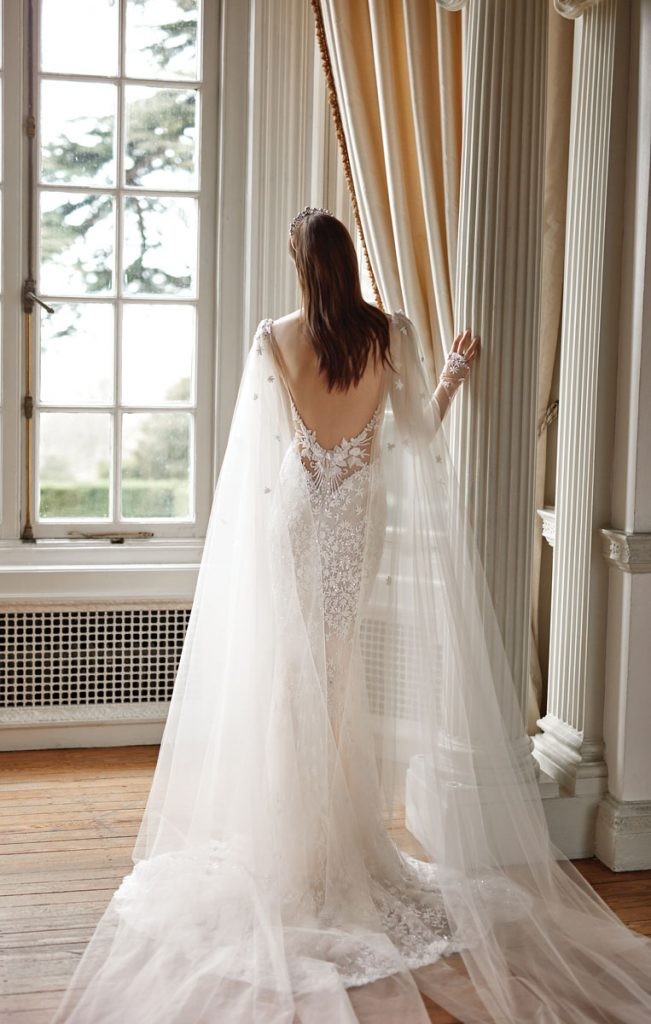 Donatella B long-sleeve blush and ivory gown with hand-embroidered jasmine flowers ($9,600), blush cape with hand-embroidered jasmine flowers ($1,320), Galia Lahav, Miami