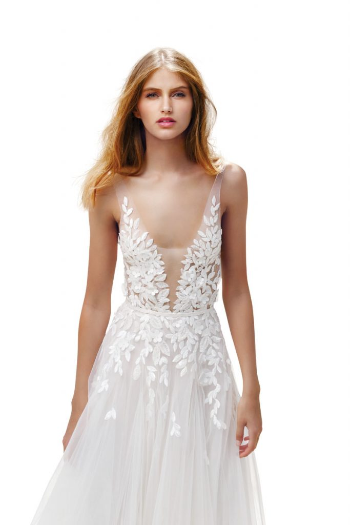 Elli low-V-neck silk tulle gown in ivory adorned with scattered sparkling leaf appliqués and floral accents ($9,790), Mira Zwillinger
