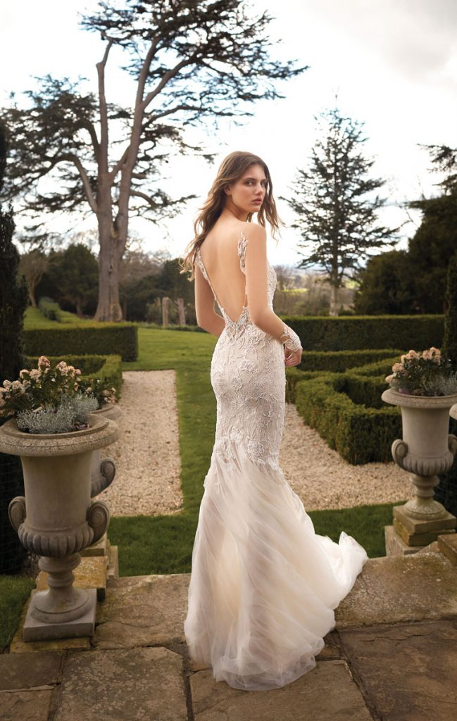 Gala 510B trumpet gown in blush and ivory sheer silk tulle with floral appliqués and beaded lace ($6,380), Galia Lahav, Miami
