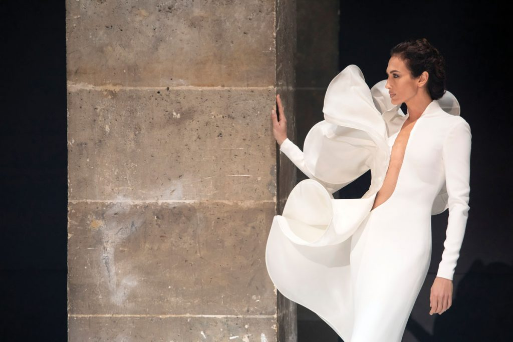 Haute Couture white crêpe sheath dress with sculpted gazar flounce (price upon request), Stéphane Rolland