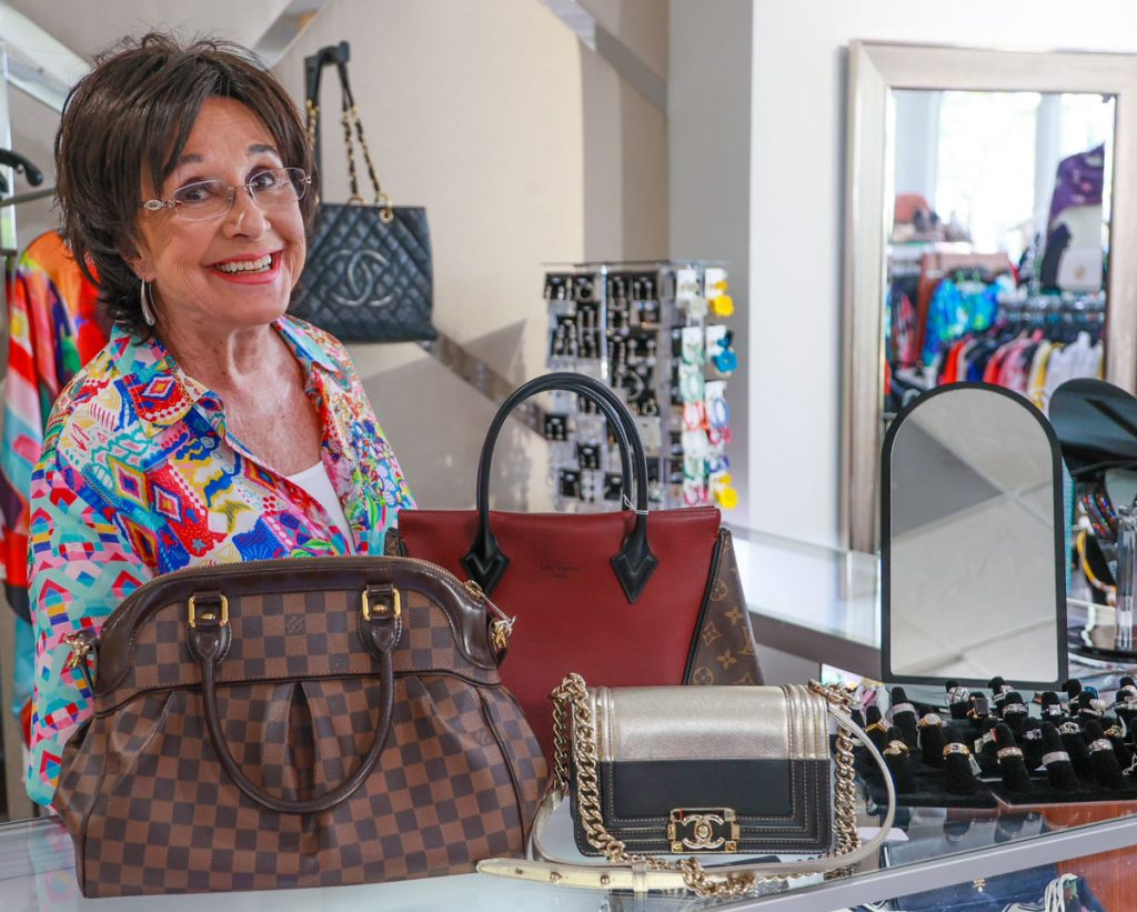 Carolyn Lancaster with some of her store's handbags
