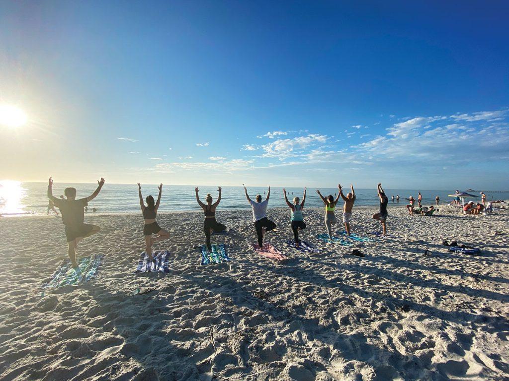 A Donation Yoga Naples class on the beach