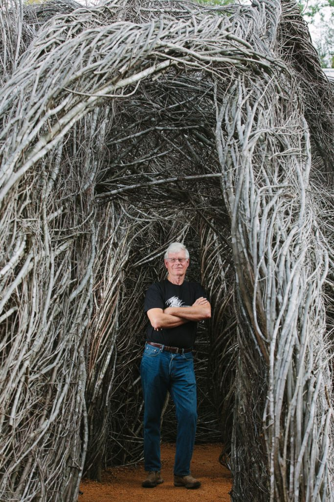 """Patrick Dougherty with """"Homegrown."""" Photo by Briana Brough"""